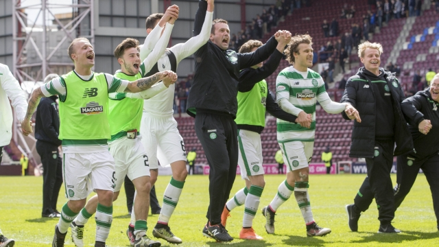 Celtic manager Ronny Deila and his team celebrate at the end of the match at Tynecastle