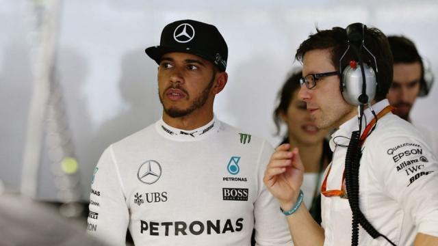 Lewis Hamilton talks to his engineer Peter Bonnington in the garage
