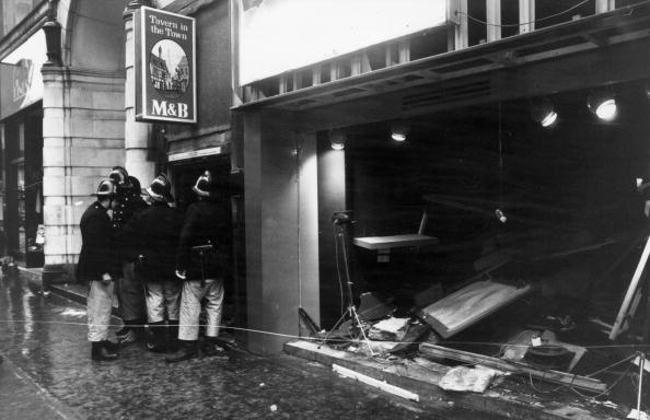 Firemen survey the damage outside the Birmingham pub, Tavern in the Town, after the IRA bomb blast. (Photo by Wesley/Keystone/Getty Images)