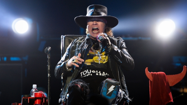 Aussie rockers AC/DC wrote a new chapter in their 42-year career on today, launching a European tour with Guns N' Roses' Axl Rose replacing Brian Johnson as frontman.