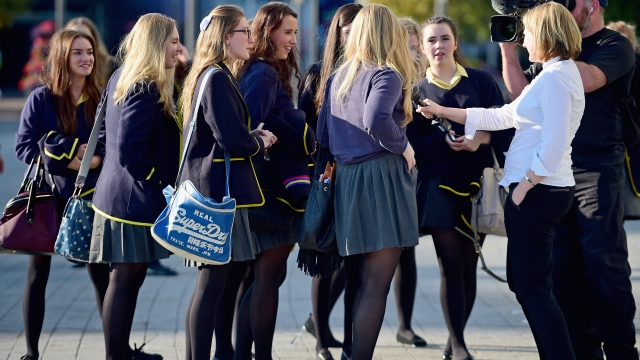 Sixteen year old first time voters depart the SSE Hydro following The Big, Big Debate before the Scottish Independence Referendum in 2014