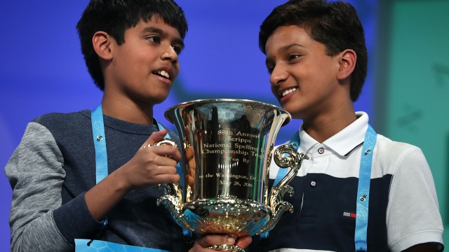 Spellers Nihar Janga (L) and Jairam Hathwar (R) hold a trophy after the finals of the 2016 Scripps National Spelling Bee