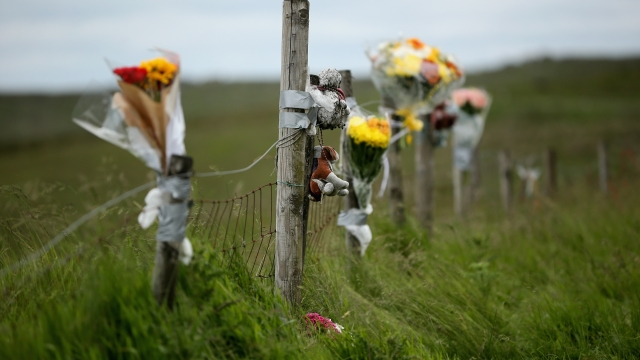 Floral tributes overlook Saddleworth Moor where the body of missing Keith Bennett may be buried. Fifty years ago Keith Bennet was snatched by moors murderers Ian Brady and Myra Hindley and they have never disclosed the location of his burial.