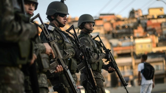 Brazilian marines stand guard in the streets of the Mare favela for the last time before being withdrawn