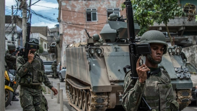 Brazilian marines take part in an operation at the Vila Olimpica shantytown, in the Mare favela, in Rio de Janeiro, after heavy shooting in 2015