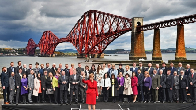 Nicola Sturgeon poses with the SNP's 56 new MPs after the 2015 election.
