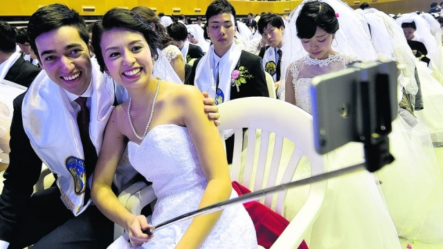 What not to do: A couple take a selfie during a mass wedding in South Korea