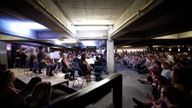 The Multi-Story Orchestra perform in a car park in Peckham, south London, led by conductor Christopher Stark Photo by Mary Turner/Getty Images