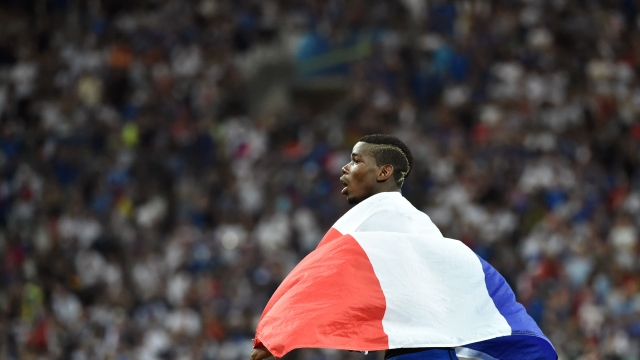 France's midfielder Paul Pogba celebrates at the end of the Euro 2016 semi-final football match between Germany and France