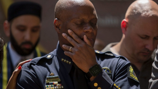 Dallas Police Chief David Brown prays during a vigil following the shootings which left five of the Texan city's police officers dead.