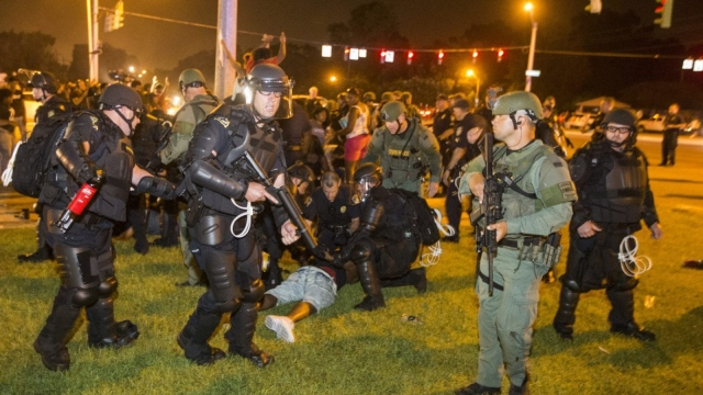 Police rush protesters in Baton Rouge, Louisiana, on Saturday night following the death of Alton Sterling, who was shot dead while being restrained by officers in the city