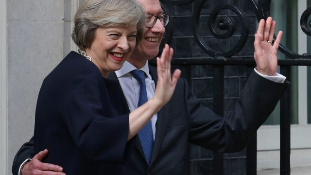 Britain's new Prime Minister Theresa May and her husband Philip John outside 10 Downing Street (Photo: Getty)