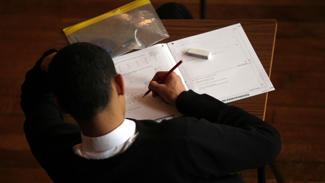 pupil studying at desk