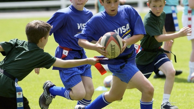 Even mild blows to the head in children, such as when playing rugby, can have long-term health effects, researchers said.