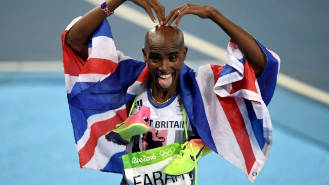 Mo Farah, pictured after winning gold in the Men's 5000m Final at the Rio Olympics, is knighted in the New Year Honours. (Photo: Getty Images)