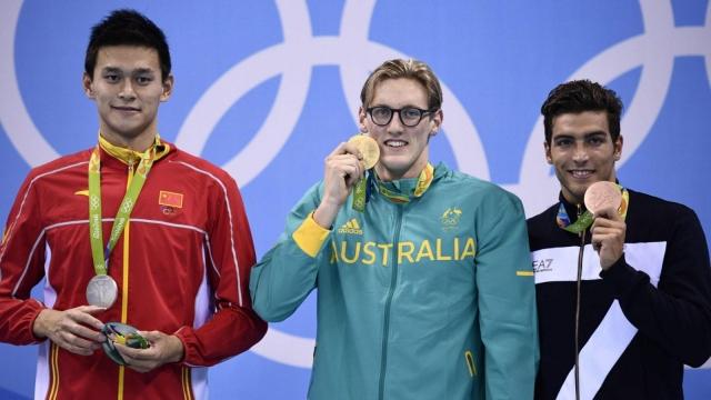 Australia's Mack Horton celebrates his gold on the podium with silver medallist Sun Yang on his left (Photo: Getty)