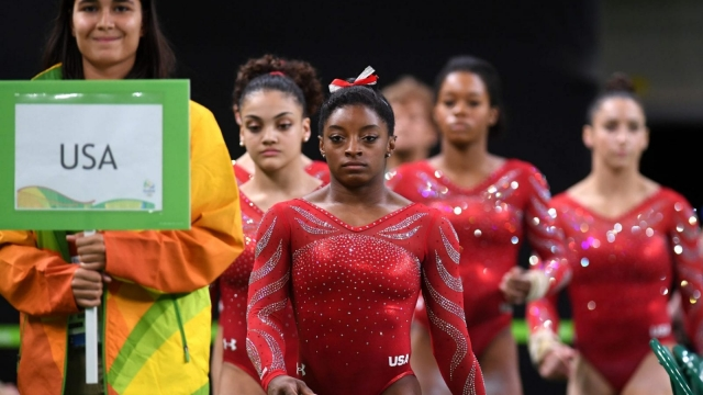 """Simone Biles, the US gymnast who is favourite to take gold, is 4'9"""" (Photo: Getty)"""