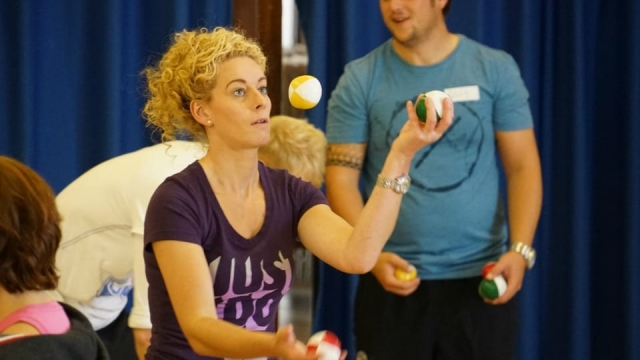 Teaching assistant Victoria Hardy learns to juggle on the six-day circus skills course