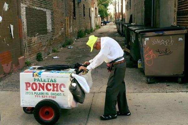 Fidencio Sanchez pushing his paleta cart