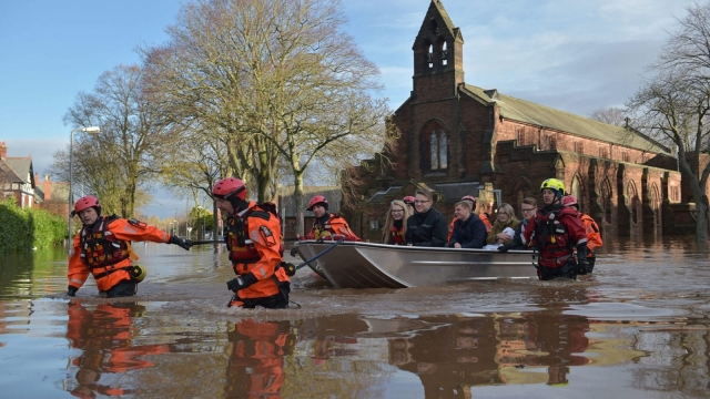 Rescue teams in Carlisle, Cumbria. Thousands of homes across the North of England were evacuated during winter floods in 2016. (Photo by Jeff J Mitchell/Getty Images)