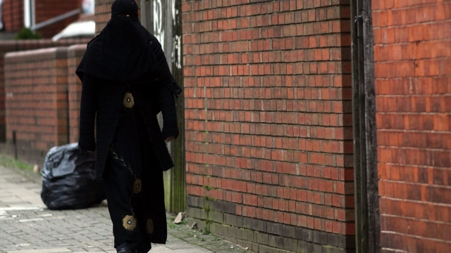 Article thumbnail: A woman wearing a burka walks through the streets of Birmingham (Photo: Getty)