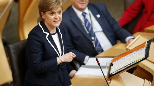 Nicola Sturgeon said she would stand behind any company that refused to comply with the new rules (Photo: PA)