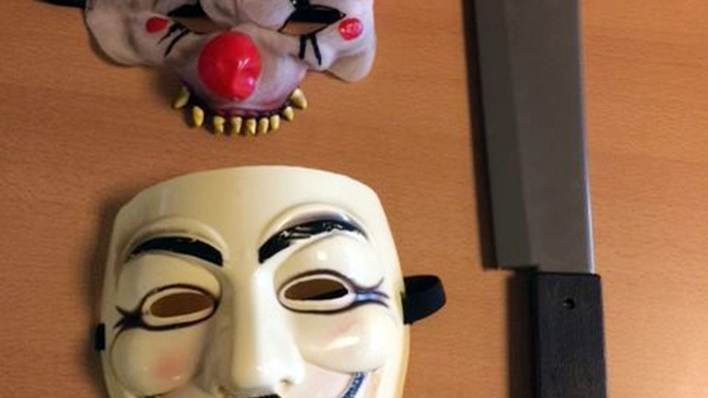 "Two clown masks and a machete that were used by two 12-year-old boys to scare children in the playground at Howletch Primary School, Peterlee, County Durham. The ""killer clown"" craze has continued to spread across the UK with one force dealing with 14 reports in 24 hours. (Photo: Press Association)"