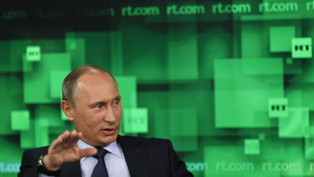 Russian leader Vladimir Putin appears on RT in 2011 (Photo: Getty)