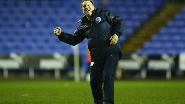 Neil Warnock celebrates victory during his reign as caretaker manager of QPR