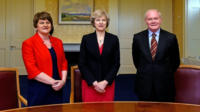 Theresa May with Northern Irish First Minister Arlene Foster of the DUP and Deputy First Minister Martin McGuinness of Sinn Féin in July (Photo: Getty)