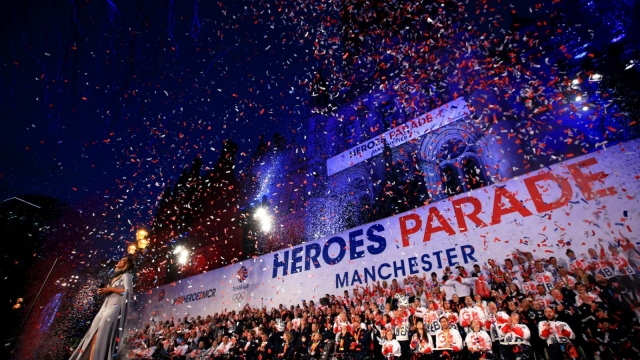 Ticker tape fills the air as Great Britain's Olympic and Paralympic heroes celebrate on stage outside Manchester Town Hall in Albert Square after a Rio 2016 victory parade. (Photo by Jan Kruger/Getty Images)