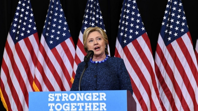 Hillary Clinton answers a question during a press conference about the FBI's investigation