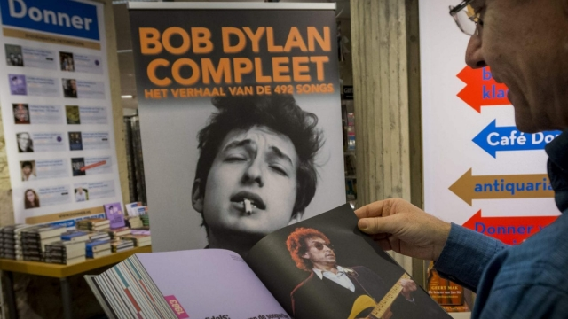 A person holds a book dedicated to US musician Bob Dylan at the bookstore Donner in Rotterdam (Photo: Getty)