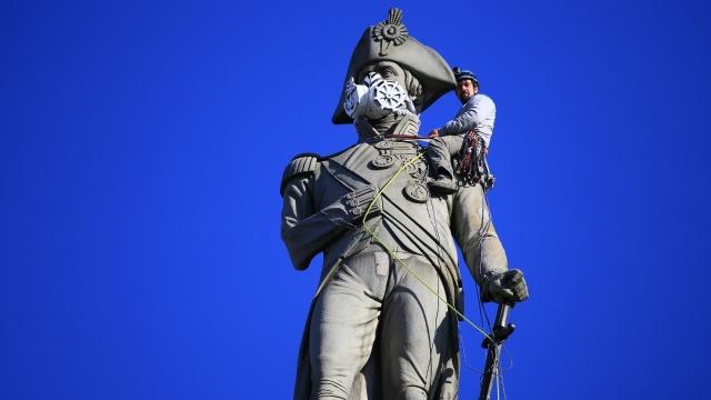 Greenpeace protestor Luke Jones on top of Nelson's Column