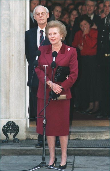 Margaret Thatcher, flanked by her husband Denis, addresses the media for the last time in front of 10 Downing Street in London prior to handing her resignation as prime minister on 28 November 1990. (Photo: Getty)