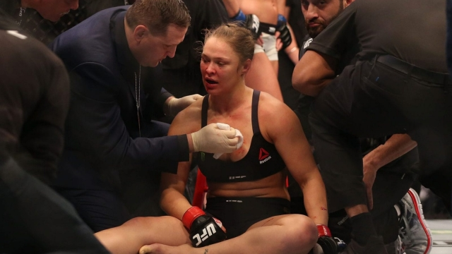 Ronda Rousey receives medical treatment after being defeated by Holly Holm in Melbourne in November 2015