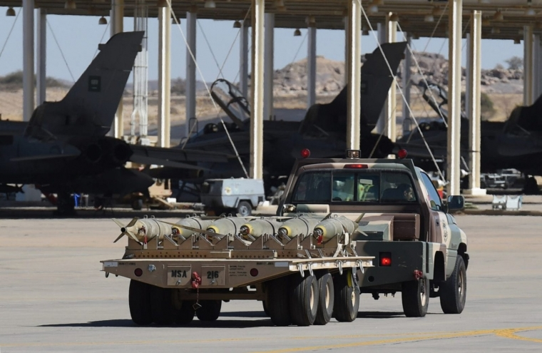 A pick-up truck loaded with bombs at a Saudi airbase used for operations over Yemen. Britain has signed off arms exports worth £3.3bn to its Gulf ally since the Saudi-led bombing campaign began, including munitions worth £1.1bn. Some 10,000 people have been killed in the fighting in Yemen. (Photo: Getty Images)
