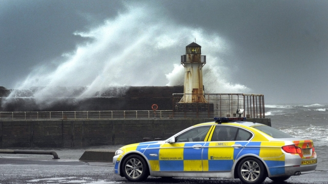 Waves crash into the harbour wall in Ardrossan in Ayrshire, Scotland as Storm Barbara hit the British coastline on December 23. A severe weather warning has been issued for Hogmanay. (Photo credit Andy Buchanan/AFP/Getty Images)