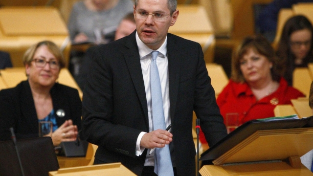 SNP Finance Secretary Derek Mackay wrote to all 32 councils saying they may be left worse off if they do not sign up to the Budget (Photo: PA)
