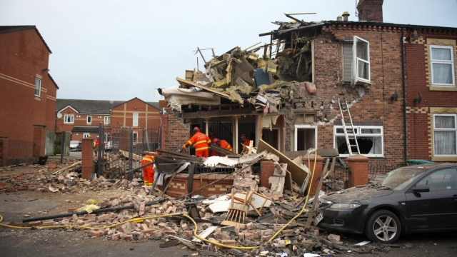 Three people were injured as an explosion rocked a terraced street in Manchester. (Picture: GMFRS)