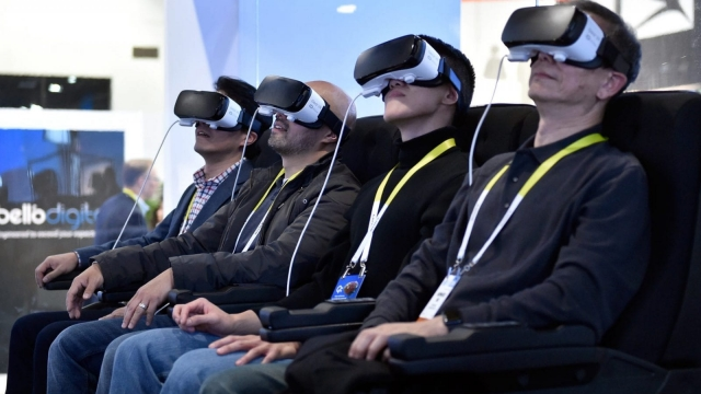 Attendees participate in a Samsung virtual reality experience at CES 2016 (Photo: Getty)