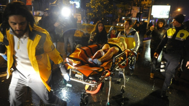 First aid officers carry an injured woman at the site of an armed attack on a nightclub in Istanbul on New Year's Day (Photo: Getty)