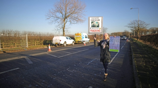 A protester holds a placard as construction begins at the Cuadrilla site in Lancashire. (Photo by Christopher Furlong/Getty Images)