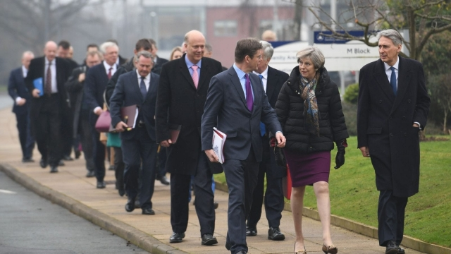 Theresa May and the Cabinet arrive in Warrington for their first regional Cabinet meeting to launch the Conservatives' new industrial strategy. (Photo: Stefan Rousseau/AFP/Getty Images)