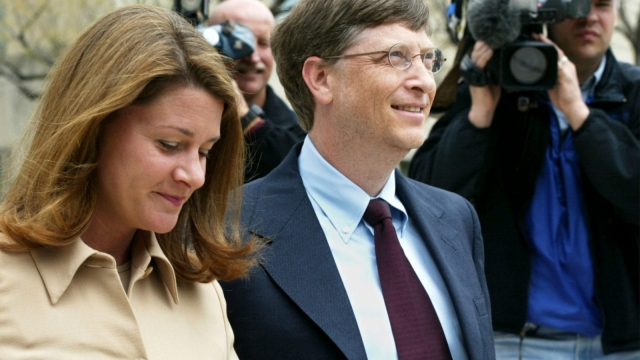 Microsoft Corp. Chairman Bill Gates arrives at U.S. District Court with his wife Melinda April 22, 2002 in Washington, DC. Gates is taking the witness stand to give his first live testimony since the antitrust case was filed against the software giant in 1998. (Photo by Alex Wong/Getty Images)