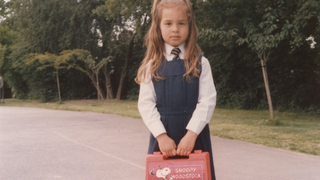 Luiza Sauma in her school uniform, shortly after arriving in London from Brazil in 1986