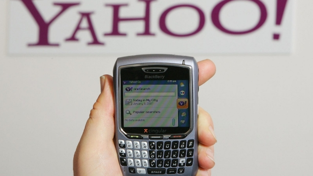 LAS VEGAS - JANUARY 09: Alex Laity of Yahoo Inc. holds a Blackberry 8700 displaying Yahoo's OneSearch mobile search home page which is part of the company's newly-launched Go For Mobile 2.0 mobile internet service at the Las Vegas Convention Center during the 2007 International Consumer Electronics Show January 9, 2007 in Las Vegas, Nevada. The world's largest consumer technology trade show runs through January 11 and features 2,700 exhibitors showing off their latest products and services to more than 150,000 attendees. (Photo by Ethan Miller/Getty Images)