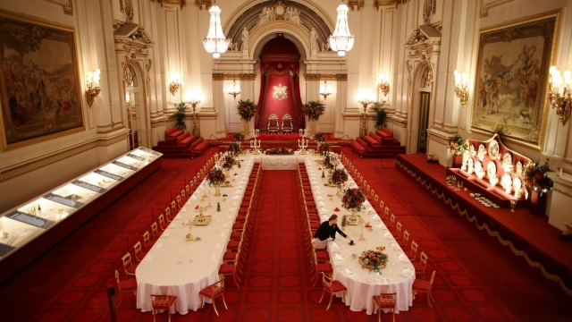 Table settings are laid out in the Palace Ballroom for a State Banquet at The Royal Welcome Summer opening exhibition at Buckingham Palace (Photo: Getty)