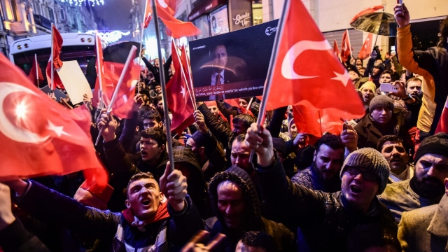 Protesters wave Turkish national flags in front of the consulate of the Netherlands in Istanbul