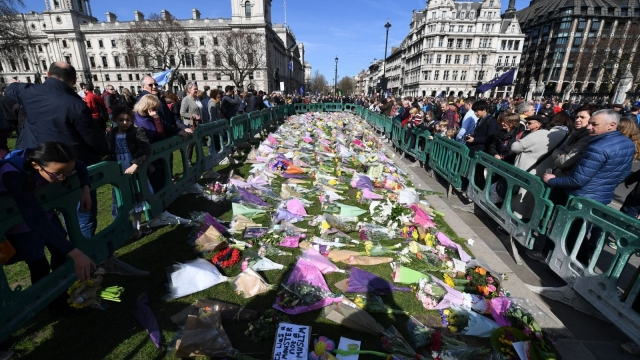 Unite for Europe marchers gather in Parliament Square around floral tributes left for victims of the Westminster terror attack (Photo: Chris J Ratcliffe/AFP/Getty Images)